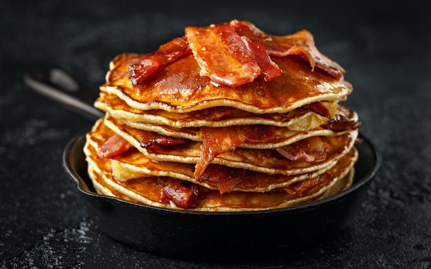 pancake stack with bacon and maple syrup toppings 14 allergen free