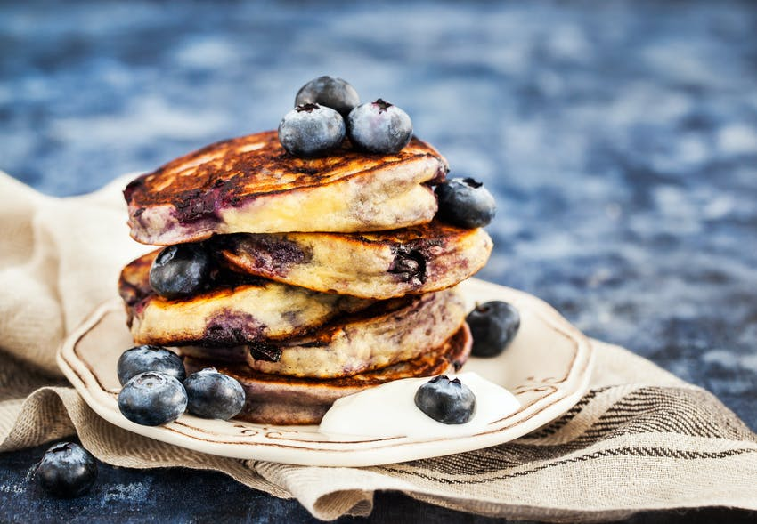 blueberry pancake stack with yoghurt and honey