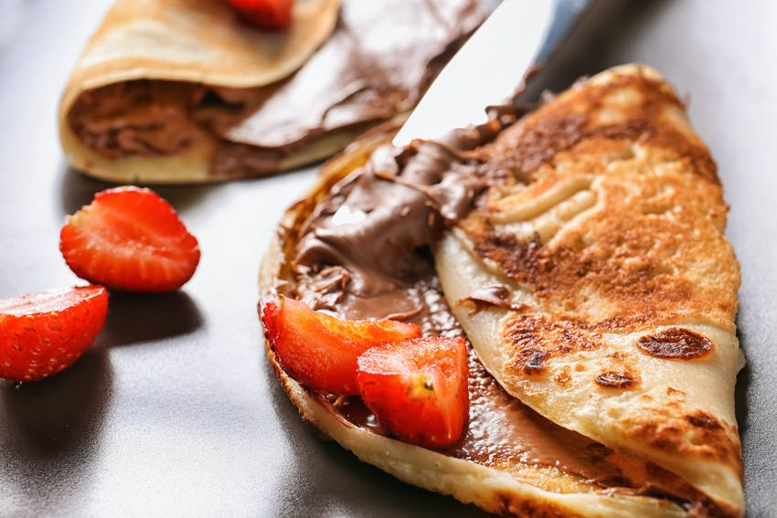 pancakes with low sugar chocolate spread and strawberries