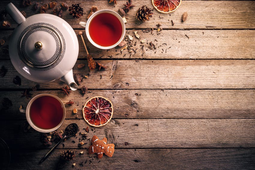 A tea pot and cups of black tea, one of the world's most famous teas