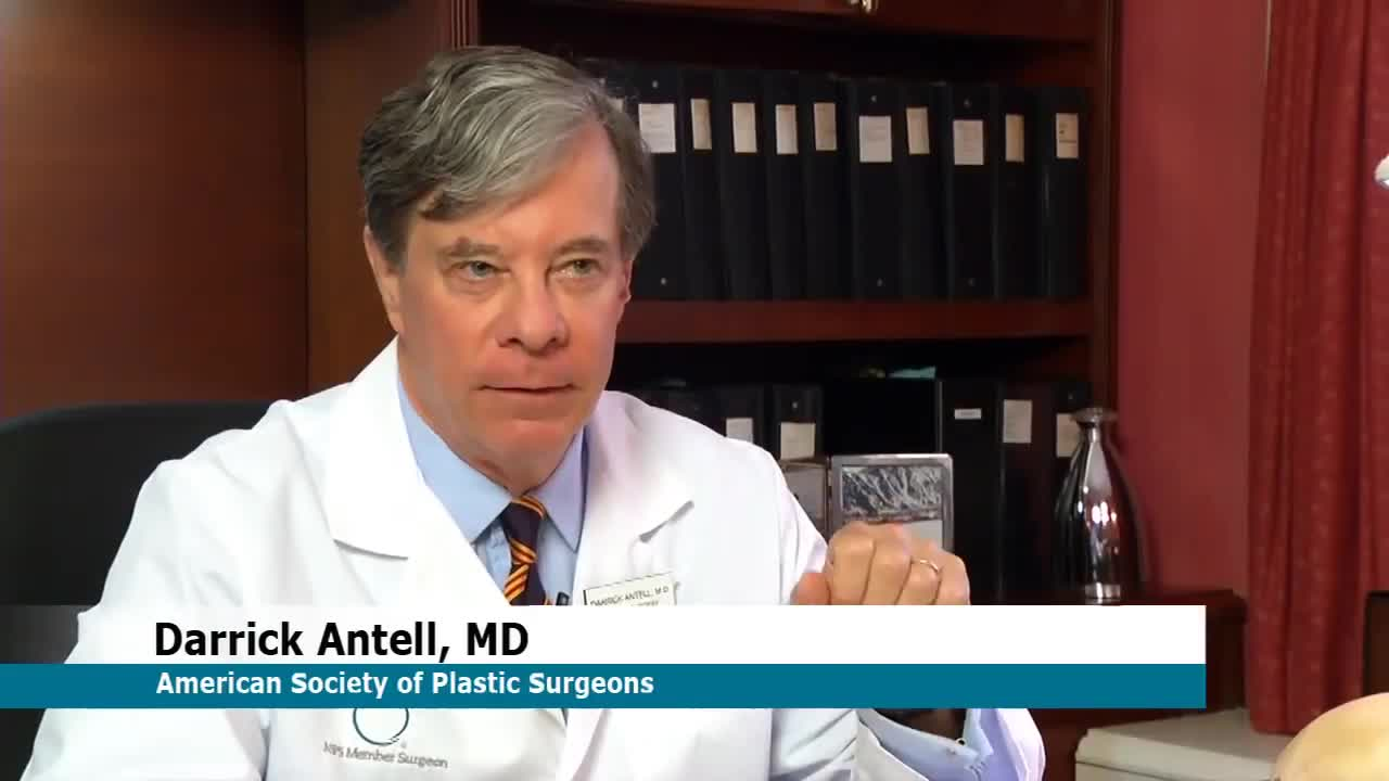 A still of Dr. Atell in lab coat.