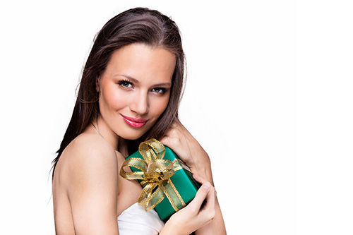 Woman holding a holiday gift