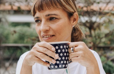 What is the menopause? Woman drinking from a coffee cup.