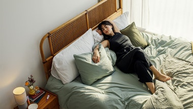Woman lying on bed looking relaxed