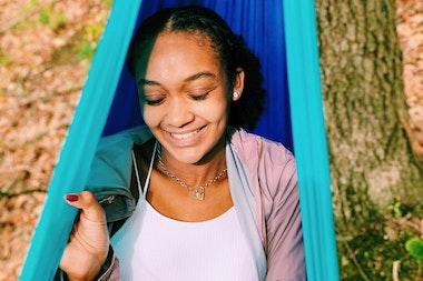Sophia smiling in a hammock