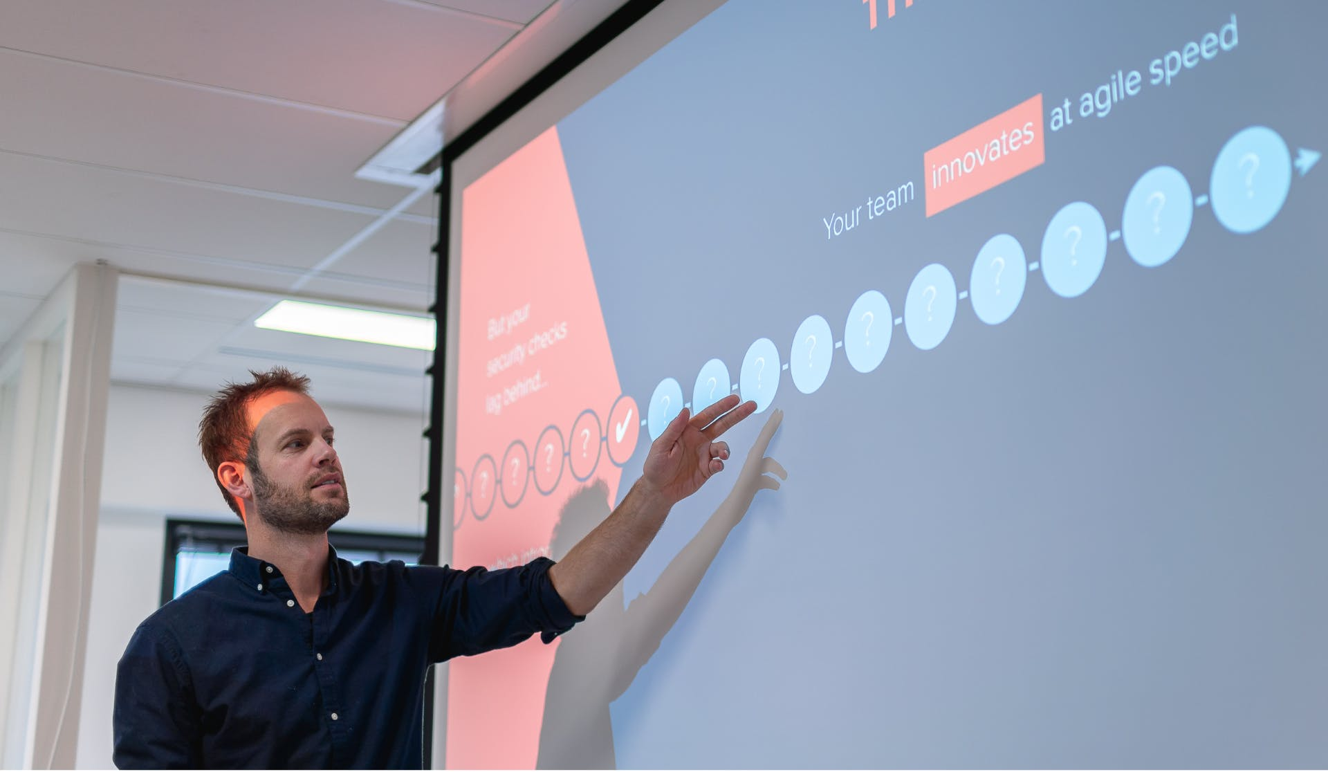 Man pointing at presentation screen
