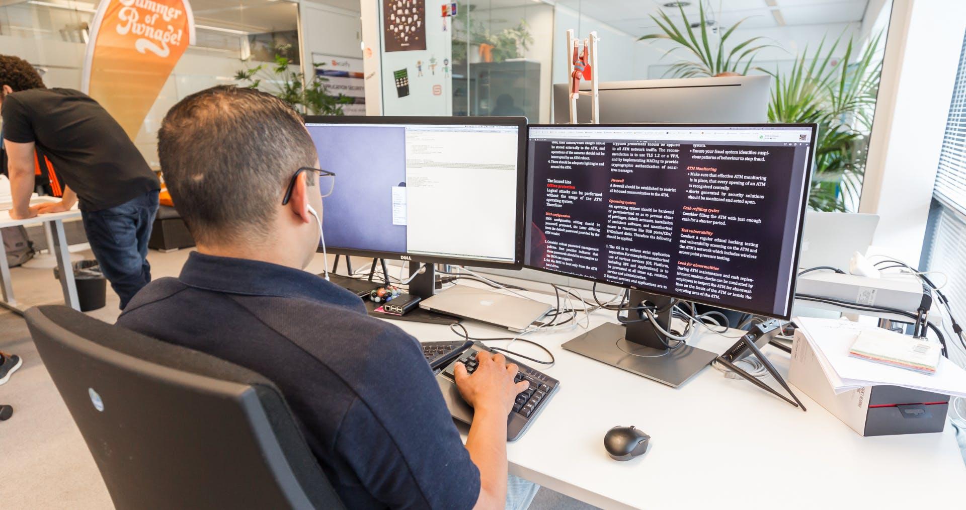 Man at work behind desk