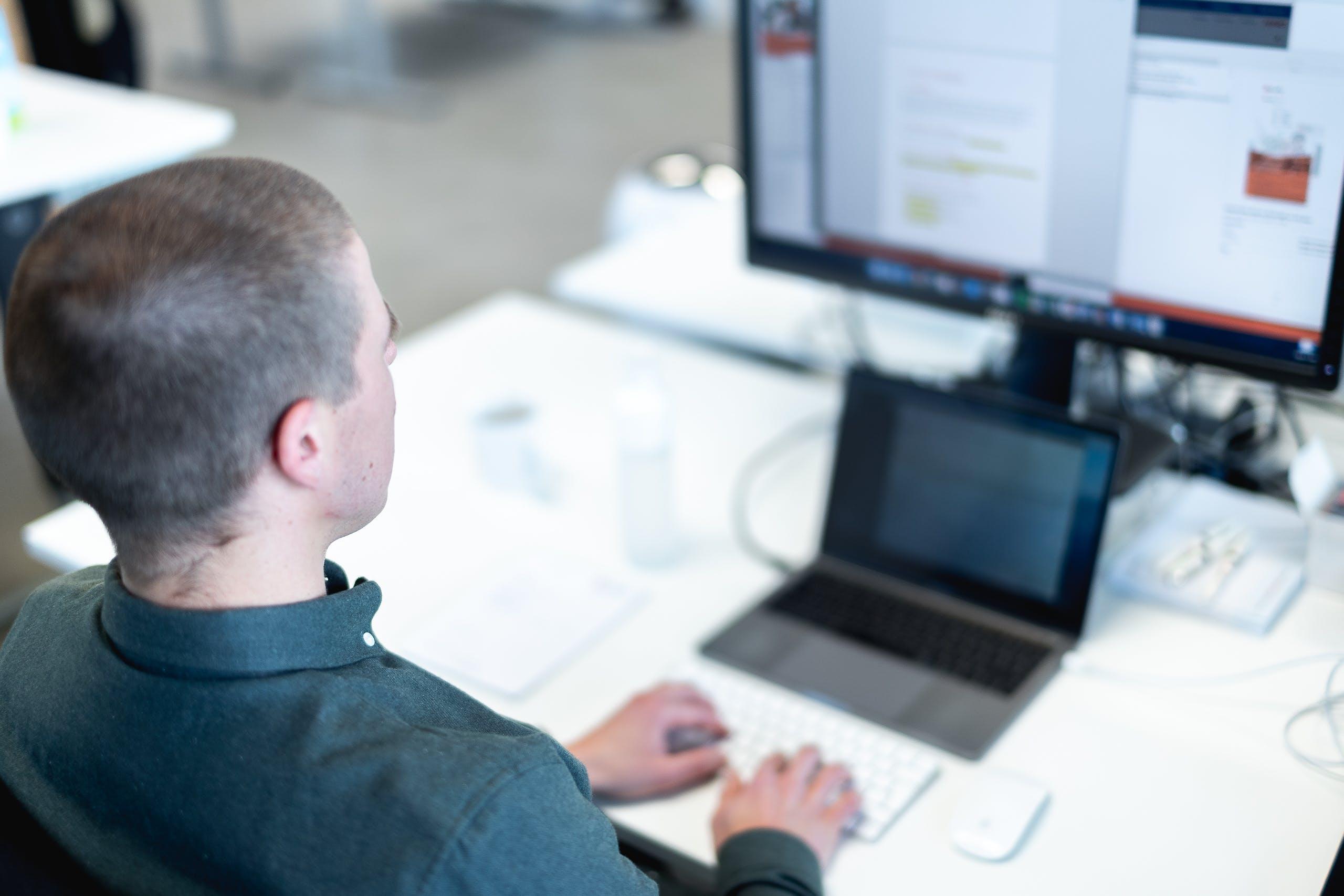 Man typing document