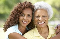 A younger and older woman with beautiful smiles
