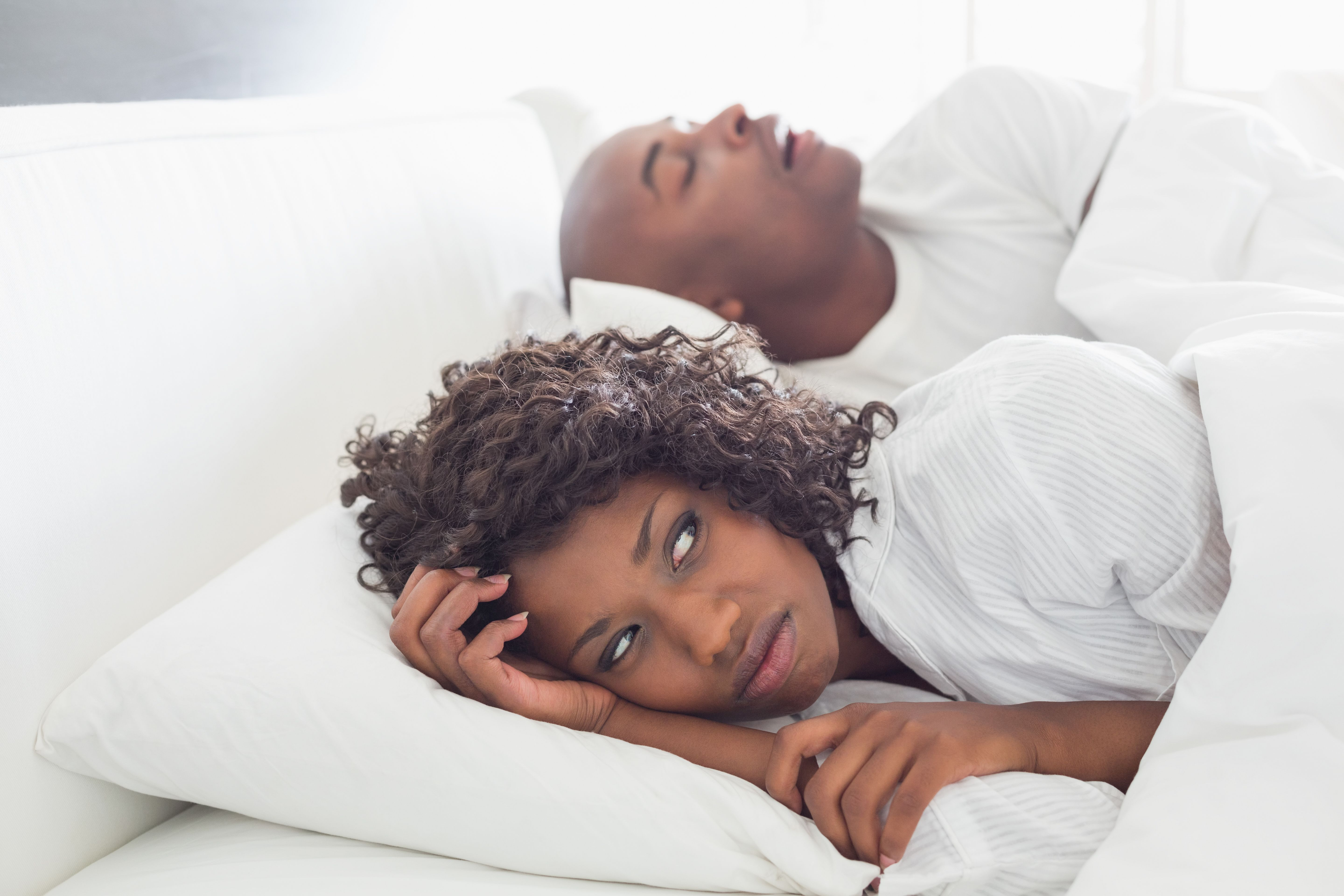A woman putting up with her partner's snoring