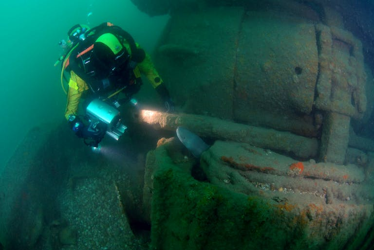 diver investigating the wreck of the bulldozer