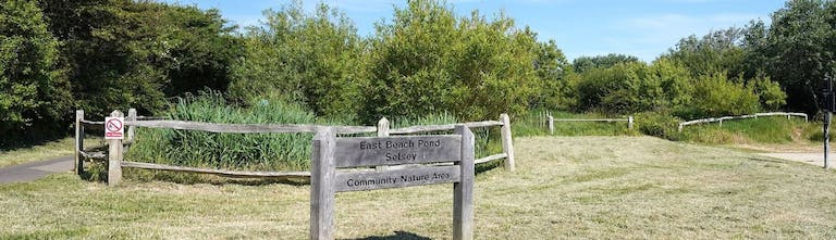 Wooden sign to East Beach Pond Selsey a community nature area