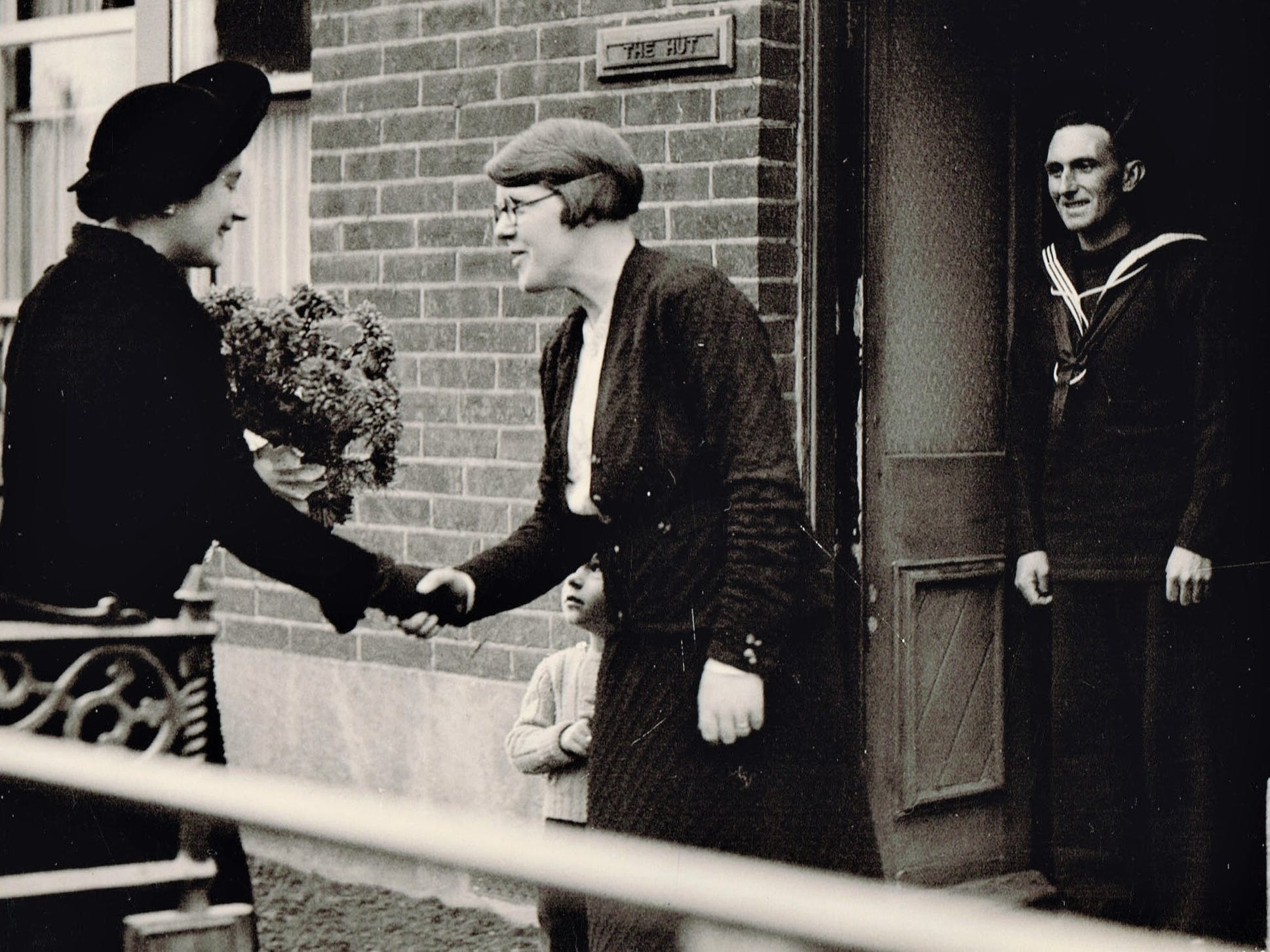 Queen Elizabeth, Queen Mother meeting Ken and Bess Maidment and son in North Road