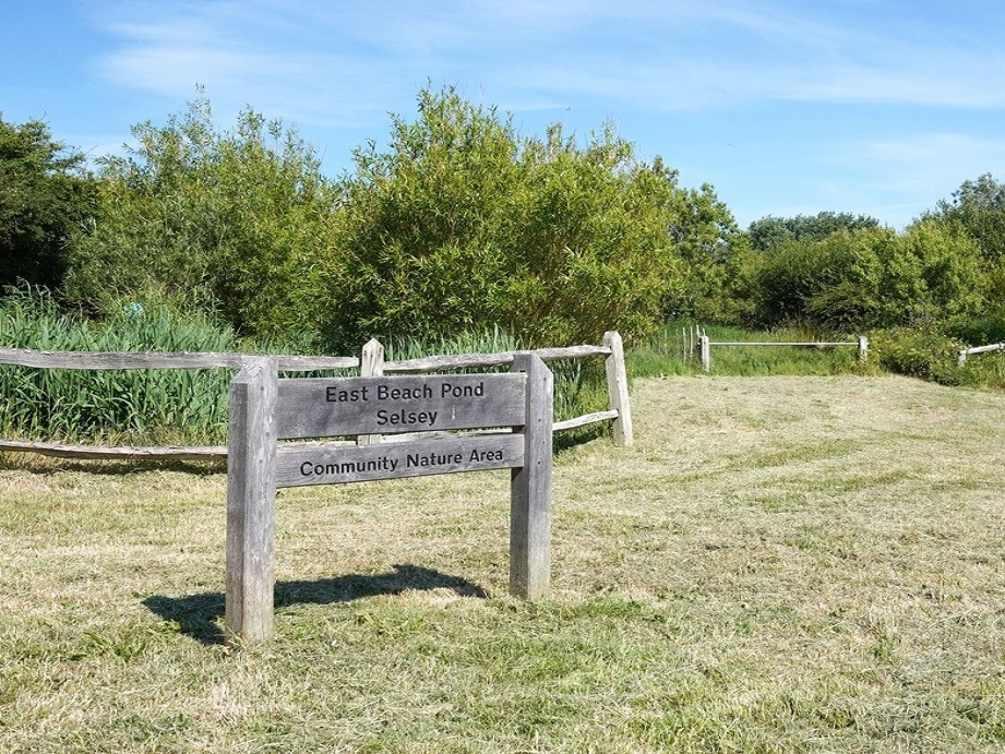 Signage at the entrance to East Beach Pond, Selsey
