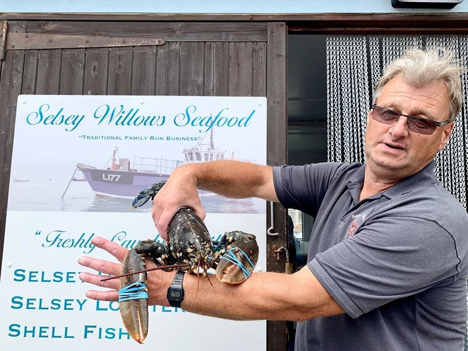 Richard holding a freshly caught live lobster
