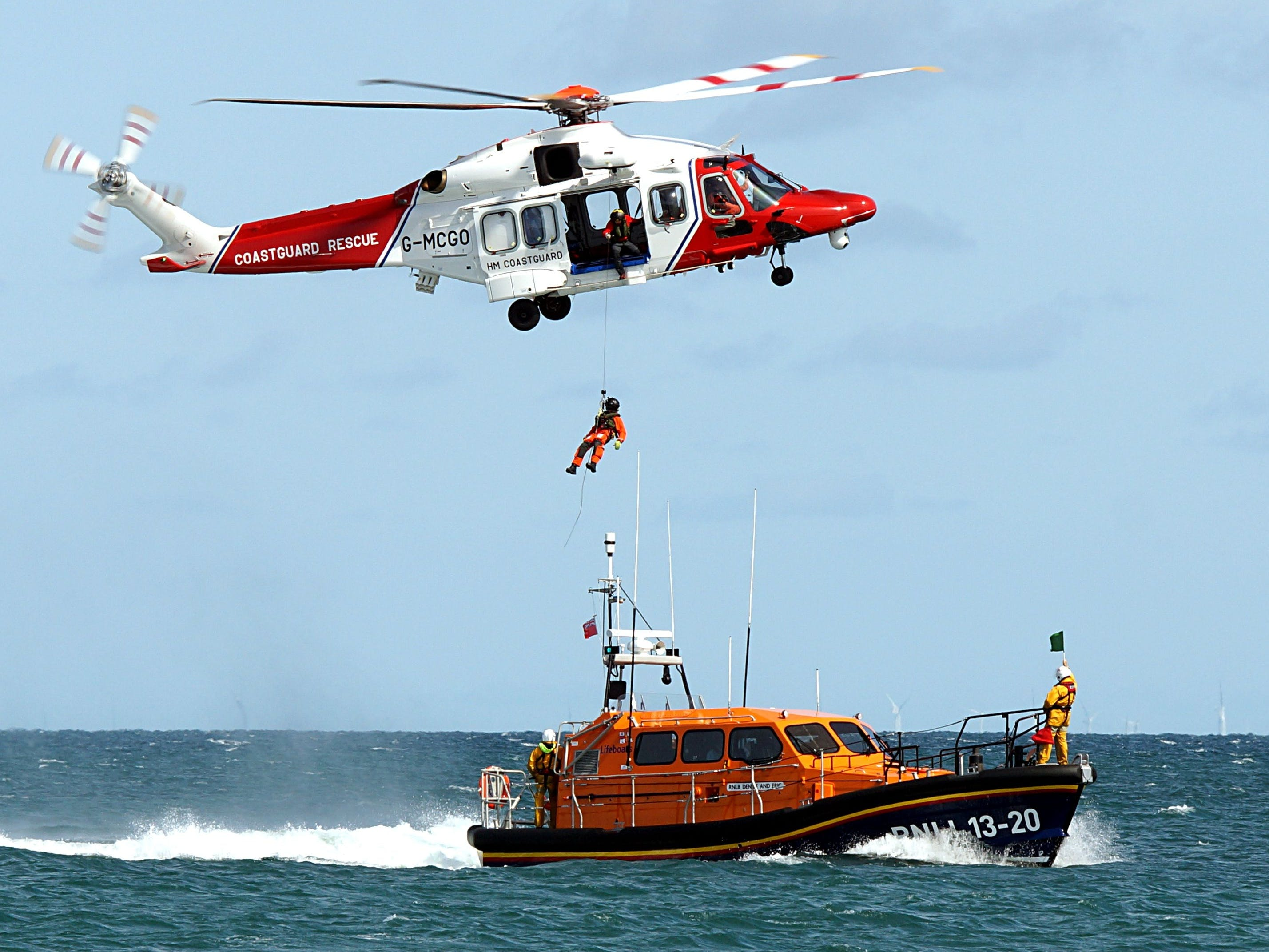 Coastguard helicopter hovering over the lifeboat during a manouvre