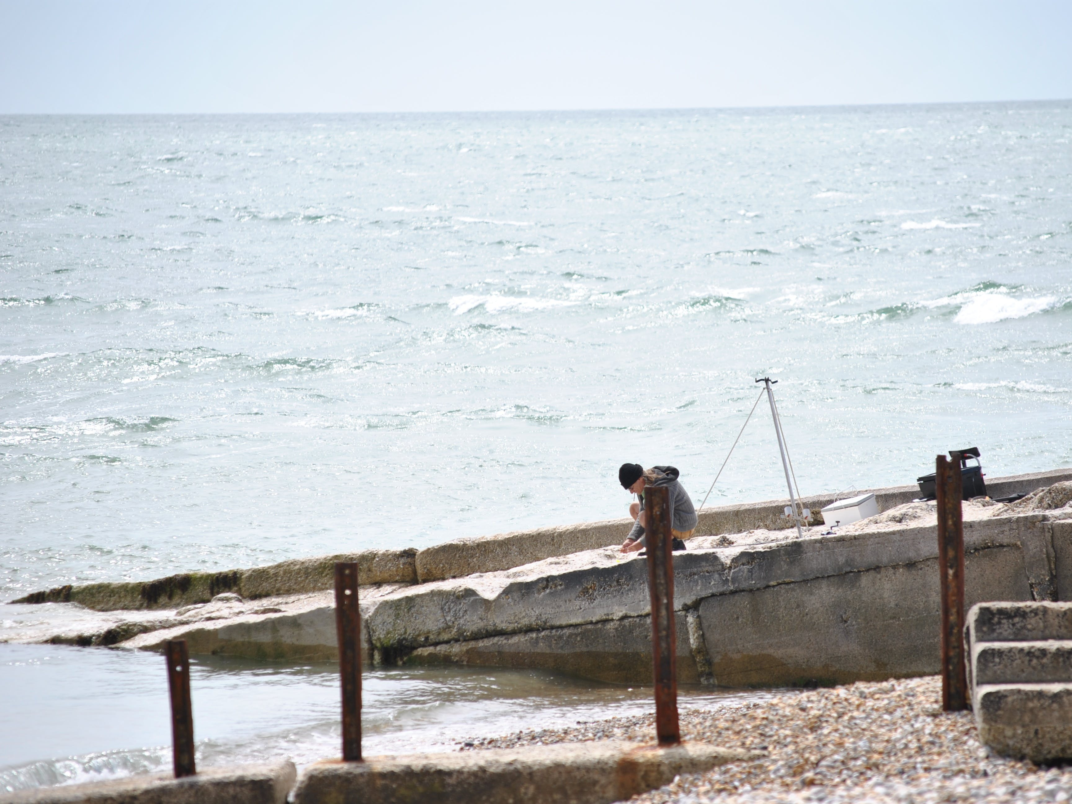Sea angler getting his bait ready for fishing at Selsey Bill