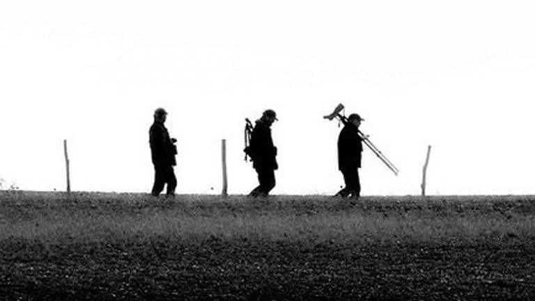Three birders with their equipment at Pagham Harbour