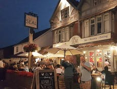 People enjoying the evening at The Seal public house in the front terraced area