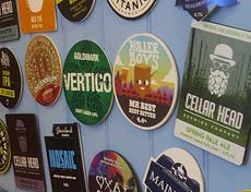 A selection of beer mats attached to the wall inside The Crab Pot, Selsey