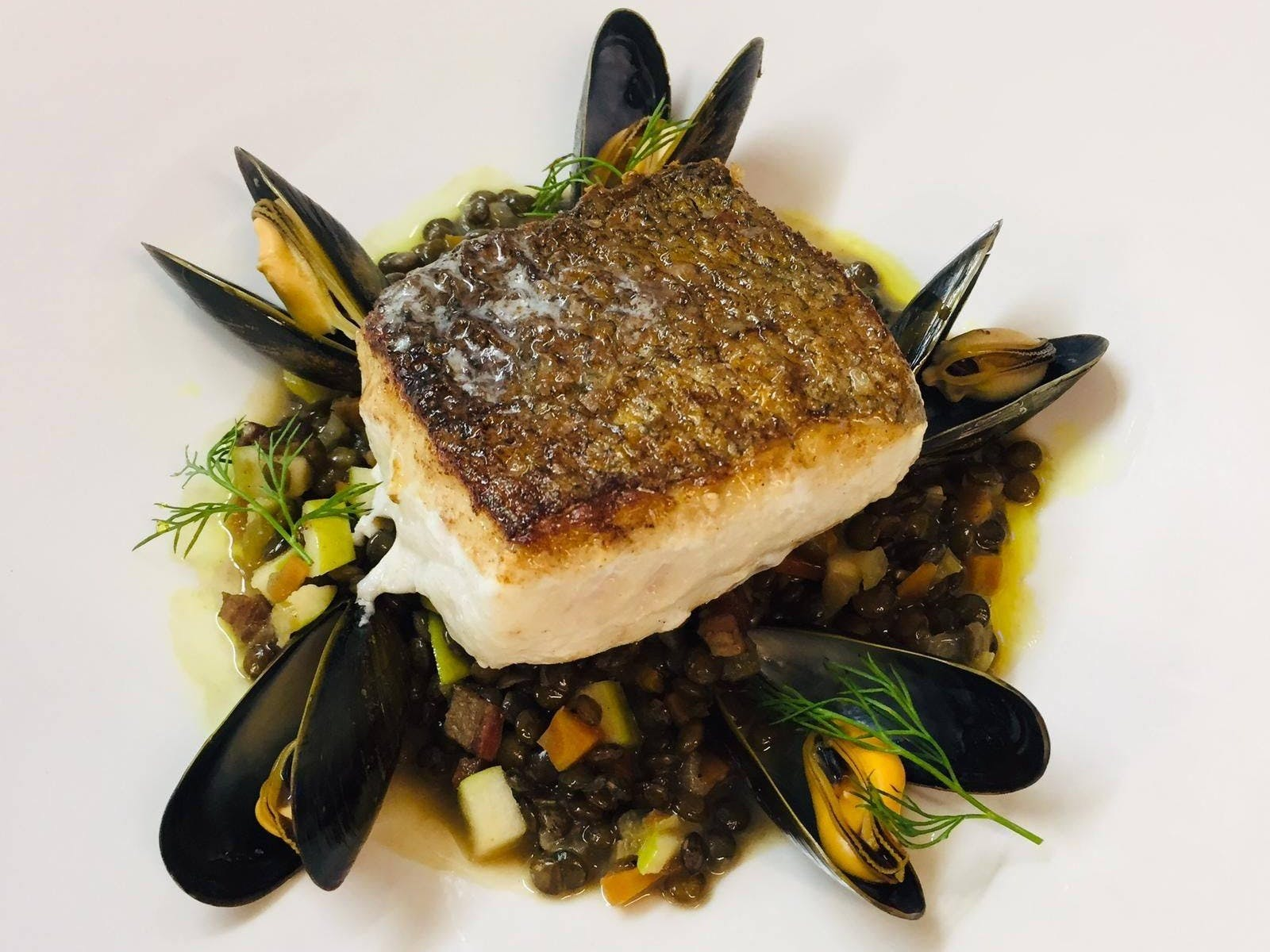 Fillet of hake, lentils, mussels, Granny Smith apple.