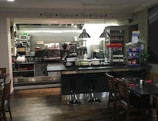 A view of the counter area and seating in Kitchen Grumpy's