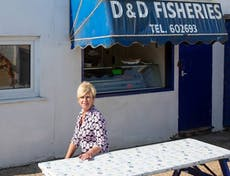 Mary Arnell outside her fresh seafood kiosk at East Beach