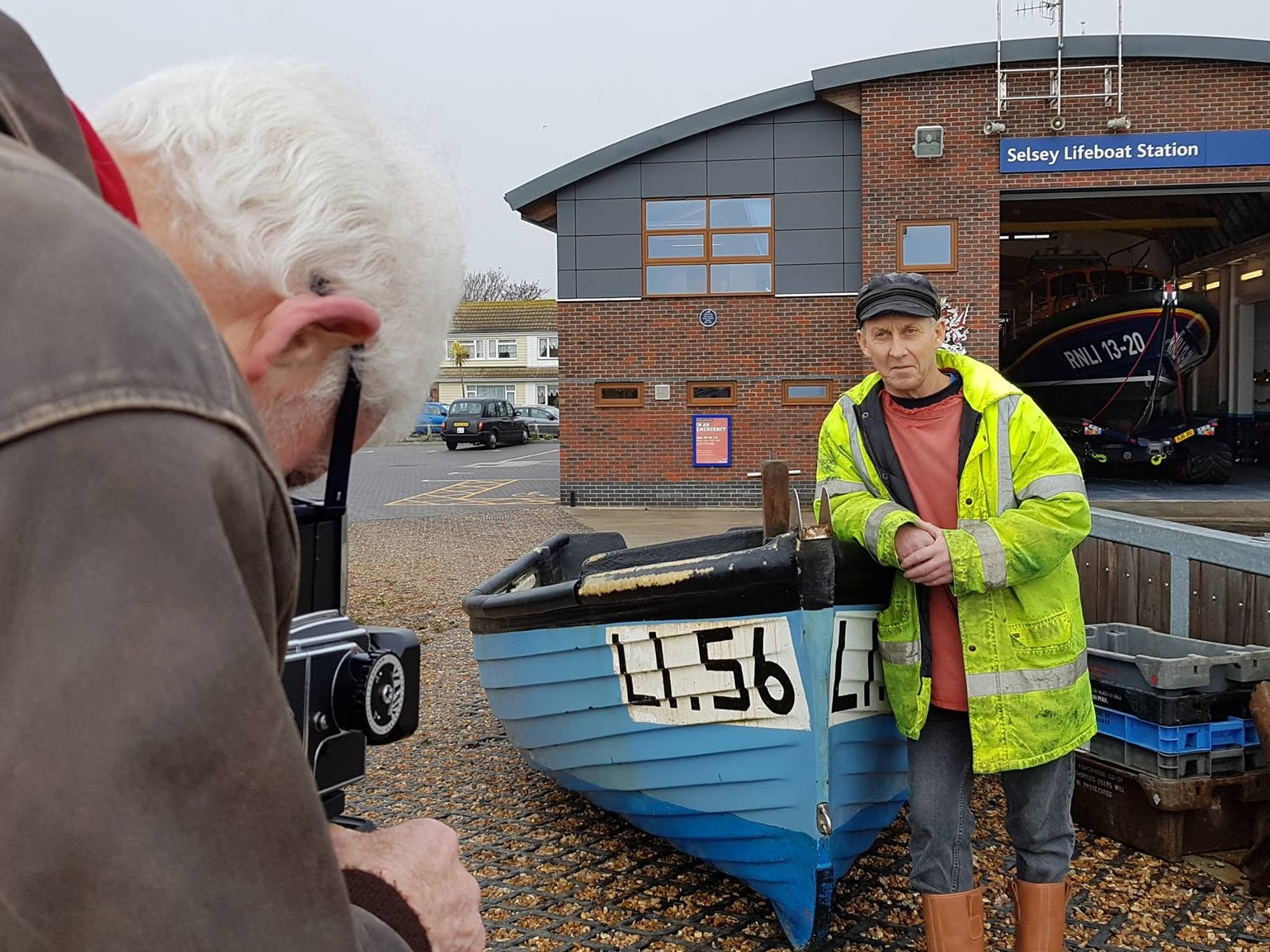 Gem, local fisherman being photographed during the Sea's the Day project outside the Selsey Lifeboat Station