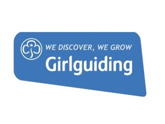 Girl guide logo with blue background and white writing we discover, we grow, girlguiding