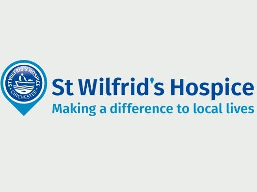 Logo for St Wilfrid's Hospice Shop in blue with the strapline making a difference to local lives