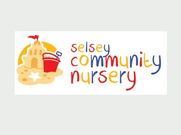 Selsey community nursery logo made up of a sandcastle and red bucket with a multi coloured red, yellow and blue writing spelling out their name