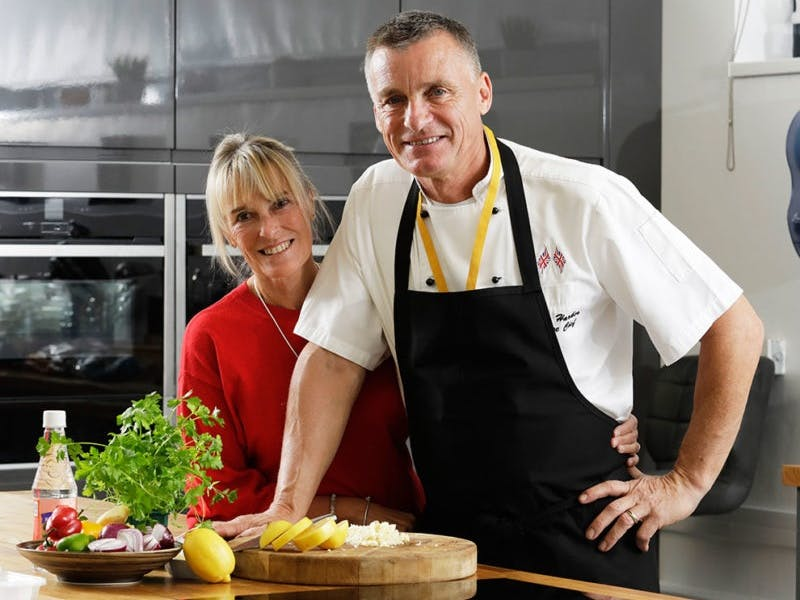 photo of Tom and Debbie of Umble Pies in their kitchen