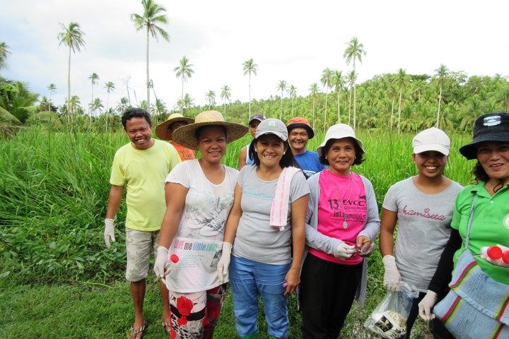 TdH NL empowered women's group in the Cagpile community in Oras plant trees with help from funds from the Department of Environment and Natural Resources (DENR)