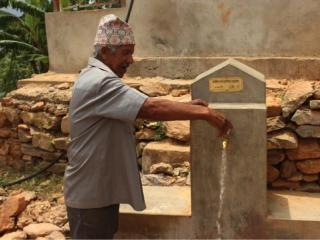 tek-bahadur-tries-the-new-tap-that-was-installed-in-his-house.jpg