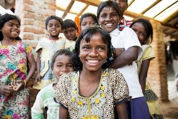 Children smiling towards the camera