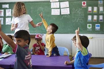Schoolteacher and children in class