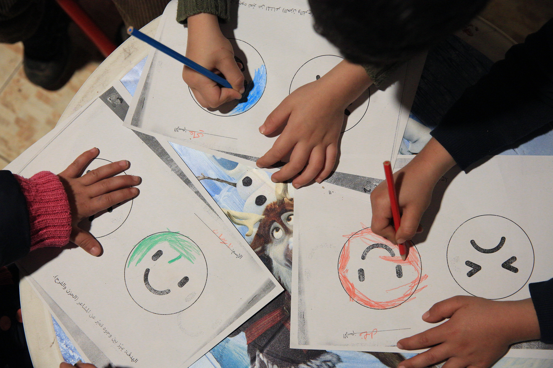 Schoolchildren drawing faces