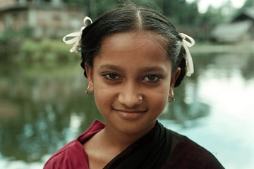 Young girl in Bangladesh looiking directly into the camera and smiling