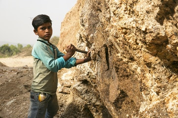 Young boy working in the Mica industry