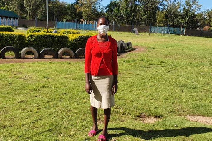 Young girl wearing a face mask for protection for COVID 19