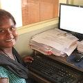 Neeraja happy behind the computer