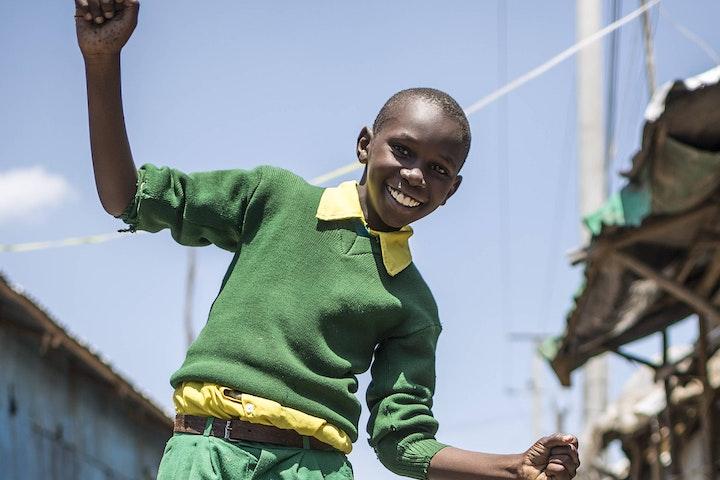 Schoolboy in informal settlement Nairobi (Kenya)