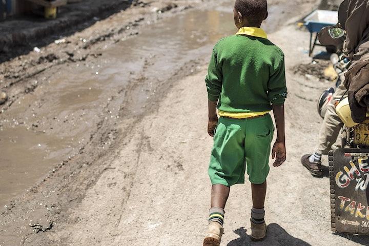 A boy walking on the street in Nairobi