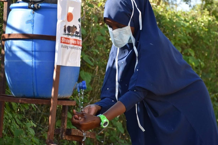 Girl washing her hands in Marsabit County, Kenya