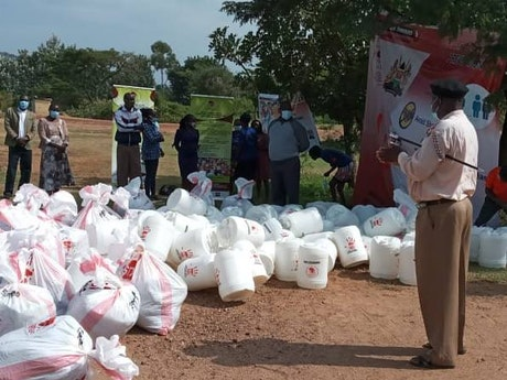 Assistant County Commissioner at the distribution of essential goods to flood victims in Busia