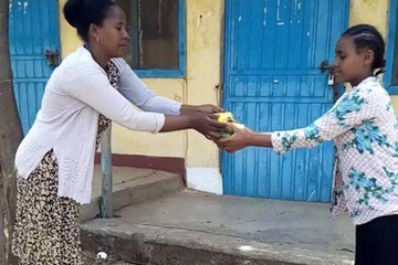 A pupil receives hygiene items to help prevent COVID-19 in Amhara Region, Ethiopia
