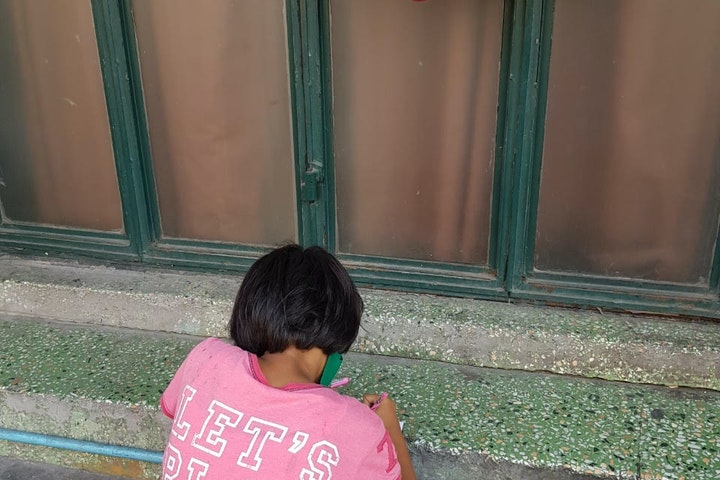Mook is a 13-year-old girl from a poor family in Thailand.