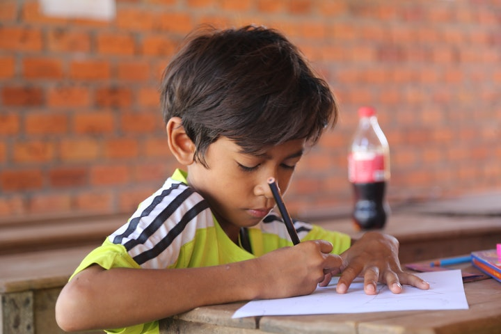 Cambodian Child Studying