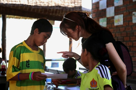 Zoe, talking to children in Siem Reap