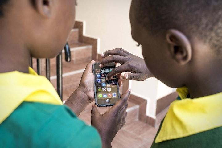 Kenyan children with a smart phone